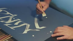 Calligrapher writes a pen. White ink. The art of calligraphy Stock Footage