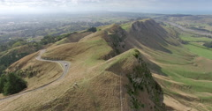 Aerial of car driving down a windy road at Te Mata Peak, New Zealand Stock Footage
