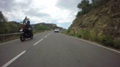 Motorcycles Overtaking in Mediterranean Road Stock Footage