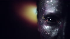 4k Cosmic Shot of a Woman with Alien make-up, Focus from Galaxy to Eye Stock Footage