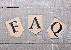 FAQ paper letter symbol motivation on wooden board. Motivation card Kuvituskuvat