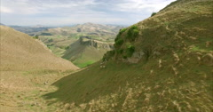 Aerial down a farm valley over sheep at Te Mata Peak, New Zealand Stock Footage