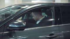 Businessman looking interior of the new car Stock Footage