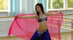 Beautiful woman dancing in arabic costume, oriental or belly dance Stock Footage