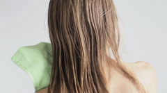 Woman drying hair Stock Footage