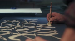 Calligraphy. Calligrapher. Art. Calligrapher writes canvas pen Stock Footage