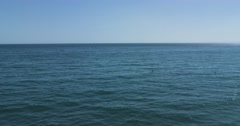 Flying over calm Mediterranean sea blue sky. 4K Red Dragon Stock Footage
