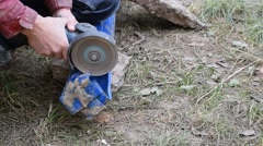 Hands cutting plastic pipe with angle grinder Stock Footage