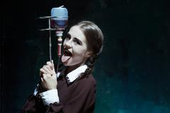 Portrait of a young girl in school uniform as a vampire woman Stock Photos