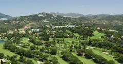 Marbella golf course near mountains. Spain 2016 Stock Footage