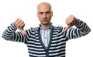 Angry bald man gesture thumbs down Stock Photos