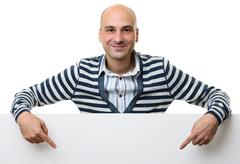 Portrait of happy man with blank advertising board Kuvituskuvat