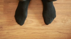 Man putting socks. man removes socks. close-up Stock Footage