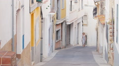 Woman tourist admiring the ancient street in the old town in Spain. Concept - Stock Footage