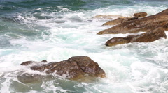 Sea waves splashing on the rocks shore Stock Footage