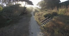 Aerial crane shot on coastal trail morning light Stock Footage
