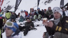 Snowboarders and skiers applause in encamp. Ski resort. Event. Happiness Stock Footage