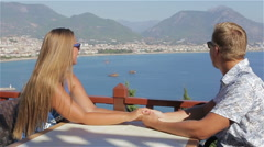 Couple on a date holding hands sitting at the table Stock Footage