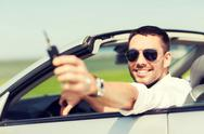 Happy man in cabriolet showing car key Stock Photos
