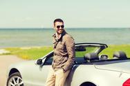 Happy man near cabriolet car outdoors Stock Photos