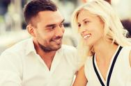 Smiling happy couple outdoors Stock Photos
