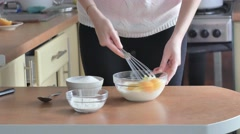 Whipped egg yolks with sugar in a glass bowl Stock Footage