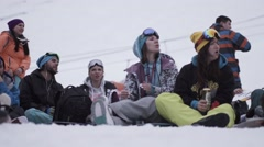 Snowboarders and skiers applause on event in encamp. Ski resort. Relax. Sport Stock Footage