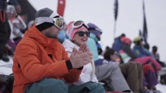 Snowboarders and skiers applaud on event in encamp. Ski resort. Finger up Stock Footage