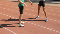 Two athlets warm up at the stadium Stock Footage