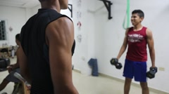 Male Latino Teens Perform Barbell and Dumbbell Curls in Gym Stock Footage