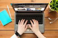 Close up of woman blogging on laptop Stock Photos