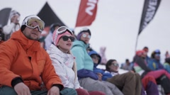 Snowboarders and skiers fascinated watching event in encamp. Ski resort Stock Footage