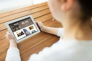 Close up of woman with blog on tablet pc Stock Photos