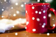 Red polka dot tea cup on wooden table Stock Photos