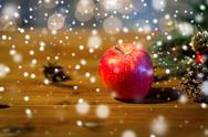 Close up of apple with fir decoration on wood Stock Photos