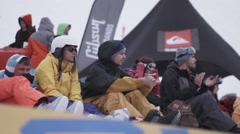 Snowboarders and skiers enjoy event in encamp. Ski resort. ent. Applause Stock Footage