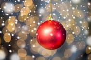 Close up of red christmas ball over golden lights Stock Photos
