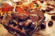 Roasted chestnuts and sweet potatoes, and panellets typical of Catalonia Stock Photos