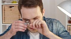 Jewelry Expert Checking Diamond Ring Stock Footage