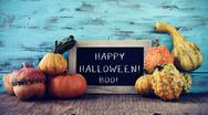Pumpkins and chalkboard with text happy halloween Stock Photos