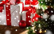 Gift boxes and red balls under christmas tree Stock Photos