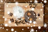 Close up of ginger dough, molds and flour on board Stock Photos