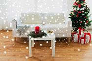 Sofa, table and christmas tree with gifts at home Stock Photos