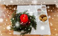 Close up of christmas wreath with candle on table Stock Photos