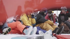 Snowboarders and skiers enjoy event in encamp. Ski resort. Red flags. Sport Stock Footage