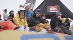 Snowboarders and skiers relax in encamp. Ski resort. Sport event. Holidays Stock Footage