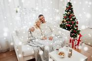 Happy couple at home with christmas tree Stock Photos