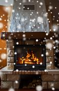 Close up of burning fireplace with snow Stock Photos