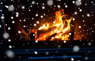 Close up of firewood burning in fireplace and snow Stock Photos