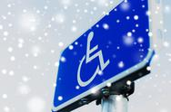 Close up of road sign for disabled over snow Stock Photos